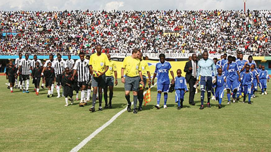 GRAND ENTRACE:  APR and TP Mazembe teams enter the field for yesterday's Orange Champions League clash at a fullpacked Amahoro national stadium. APR won the first leg tie 1-0. (Photo/ N. Etienne)