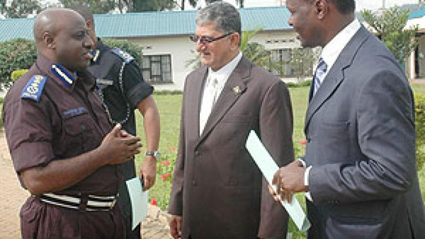 Commissioner General of Police, Emmanuel Gasana, talks to UTEXRWA Boss, Raj Rajendran (C) and the Chairman of the Private Sector Federation Robert Bayigamba yesterday(J Mbanda
