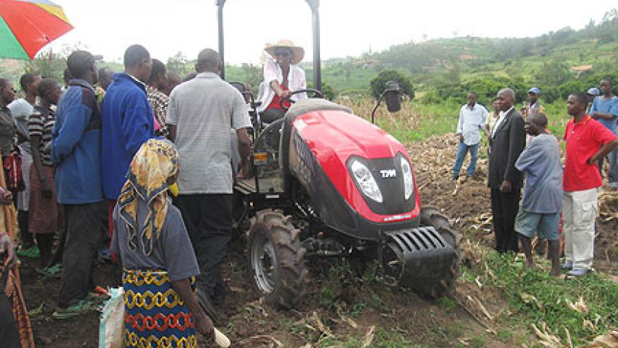 The Minister of Agriculture and Animal Resources,Dr. Agnes Kalibata driving one of the tractors. (Photo; I. Niyonshuti)