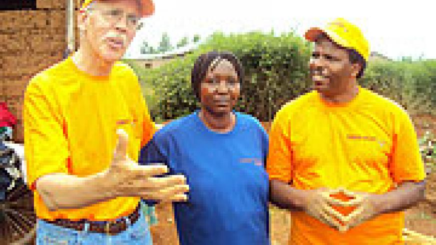World Relief Country Director Phil Smith (L) and Vice Mayor Social Affair Léonile Narumanzi (centre) at Maranyundo village. (Photo: S. Rwembeho)