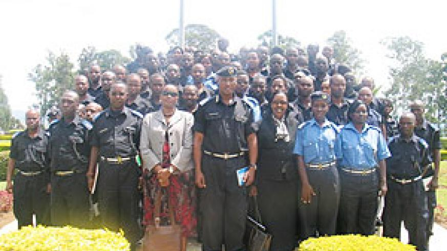Assistant Commissioner of Police Emmanuel Butera and Rose Rwabuhihi in a group photo with the trained officers.  (Courtesy Photo)