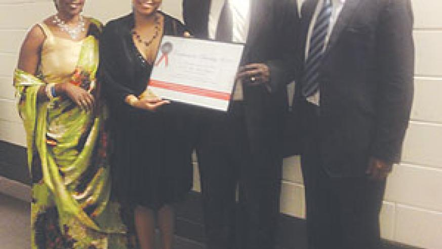 Minister of Justice, Tharcisse Karugarama (2nd from right) holding  the Diversity award. With him are Second Counsellor Enid Mbabazi, 'Unity is the Strength' representative Nadya van Pottens, the Charge d' Affaires a.i, Parfait Gahamanyi.(Courtesy photo)