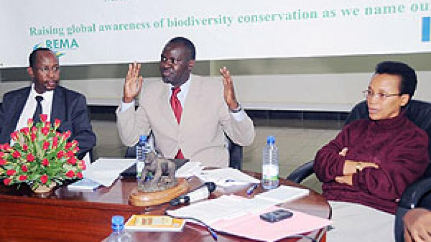 Minister of Environment, Stanislas Kamanzi makes a point. He is flanked by Rose Mukankomeje (R) and John Gara.