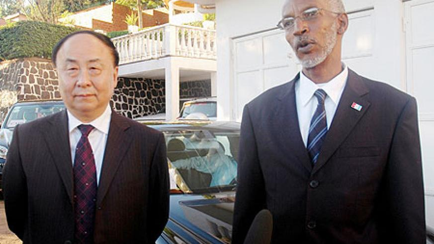 The visiting senior member of the Chinese Communist Party, Gao Shiqi, with the Secretary General of the Rwandan Patriotic Front, Francois Ngarambe. (Photo F. Goodman)