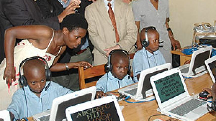 Pupils at Ecole Primaire de Kimihurura at the launch of the e-learning software yesterday. (Photo/ F. Goodman )
