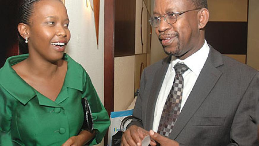 Clare Akamanzi (L), the newly appointed COO talks to the CEO, John Gara, at a recent RDB awards event. (Photo / J .Mbanda)