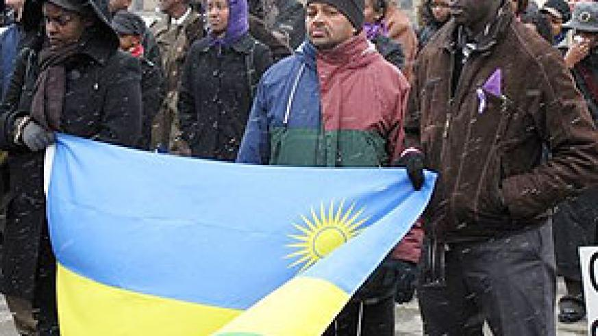 Robert Manzi (R) with members of the Rwandan Community in Canada at the commemoration event last year