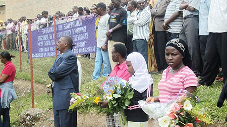 A cross section of residents paying tribute to genocide victims at Nyabisindu.(Photo: D. Sabiiti)