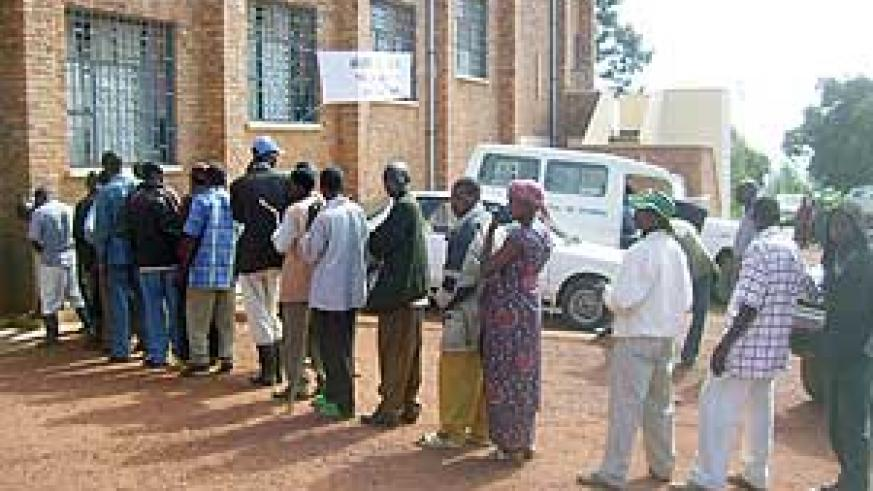 Ex-combatants lining up for medical examination at Gicumbi district on Wednesday. (Photo:  A. Gahene)