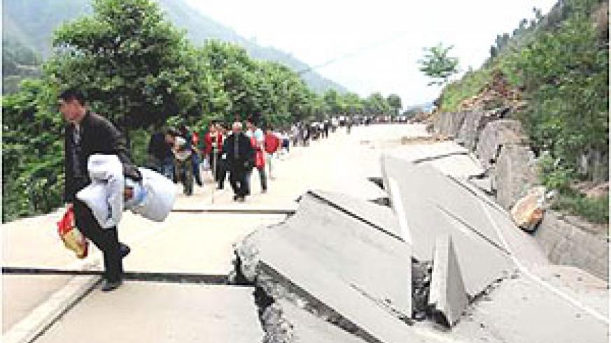 A damaged road with people migrating in search for safety