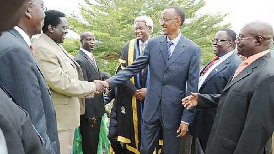 President Kagame greets members of the EALA outside Parliament buildings yesterday (Photo Urugwiro Village)