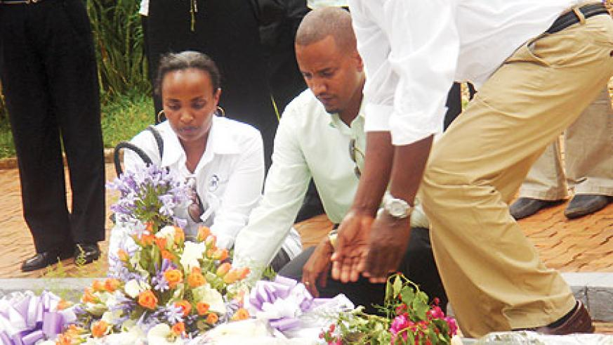 DN international CEO, Nathan Loyd and his wife laying a wreath. (Photo/ F. Ndoli)