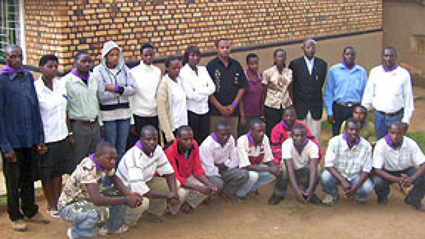 Genocide orphans pose in a group photograph with Taxi motorcyclists and Mgr. Ruzindana at their Byumba orphanage. (Photo: A. Gahene)