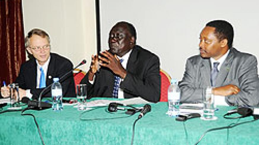 Justice Minister Tharcise Karugarama (C) Prof Anastase Shyaka, (R) and Denis Weller ,the USAID Mission Director at the opening of the workshop. (Photo J Mban