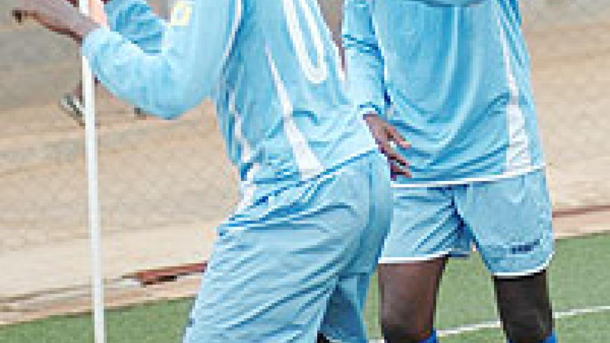 Yusuf Ndayishimiye celebrates with a teammate after scoring for Rayon in the Primus National League. The Amavubi Stars striker opened Rayon's scoring against Marines yesterday. (File photo)
