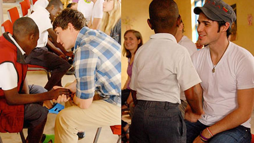 L-R : Shoe Fitting-- Many Rwandan children now have their feet protected thanks to the new shoes they recieved ; Kris Allen, the American Idol musical star enjoys a light moment with one of the children who recieved shoes. (PhotoS by Mark Darrough)