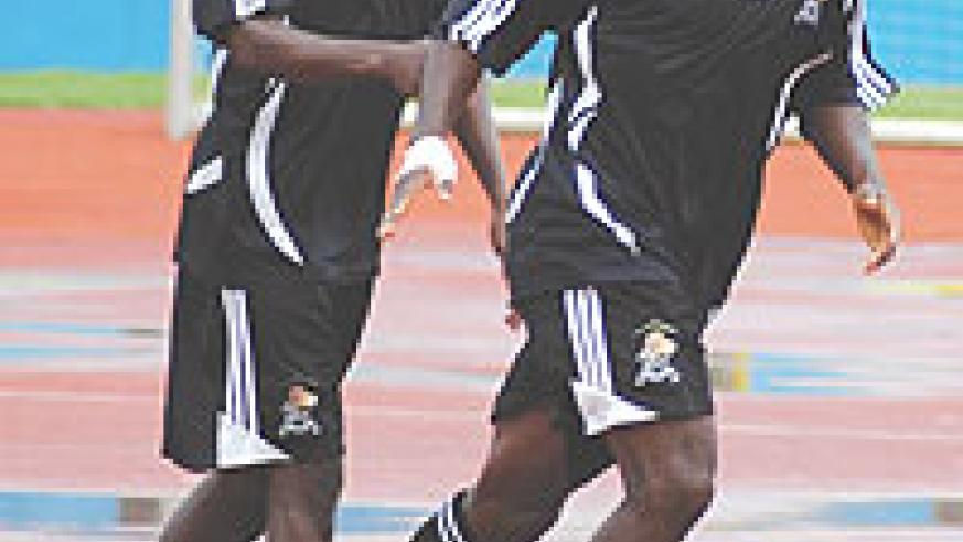 Rogba (R) being congratulated by Rassou after scoring for APR in a recent league game at Amahoro Stadium. The midfielder has earned a debut call-up on the national team. (File Photo)