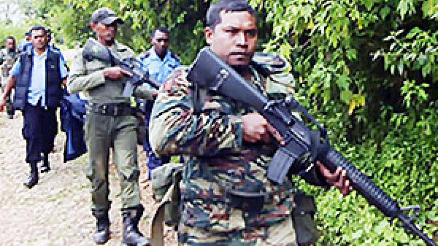 East Timorese soldiers and police patrol as part of an operation to capture rebels involved in attacks on the president and prime minister in March 2008