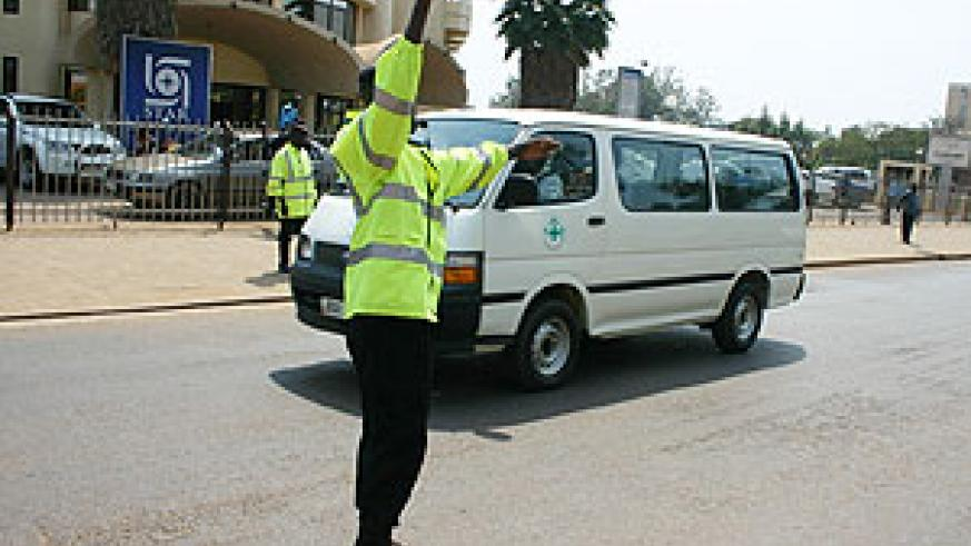 A Traffic Police officer directing traffic. Road safety is paramount.