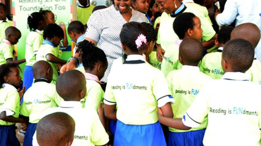 First Lady Jeannette Kagame talks to children at the end of the function at  prime holdings yesterday. (Photo J Mbanda)