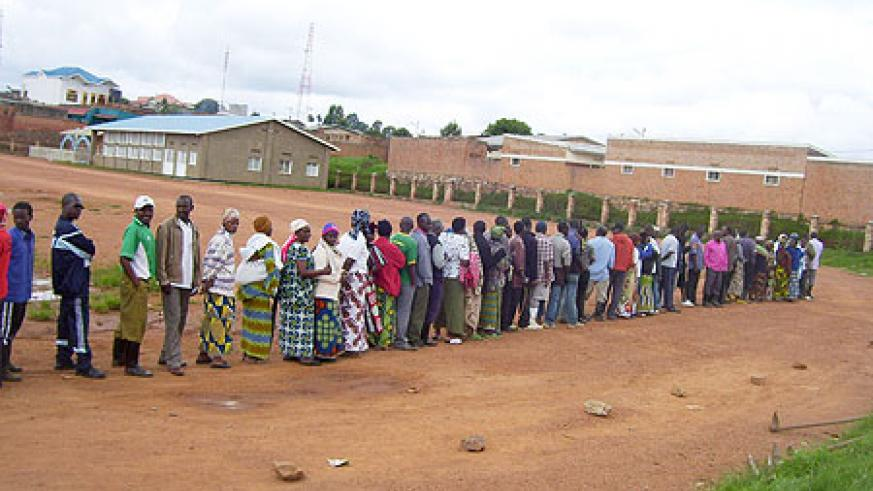RPF members of Gisuna village line up to elect their presidential candidate on Saturday. (Photo / A.Gahene)