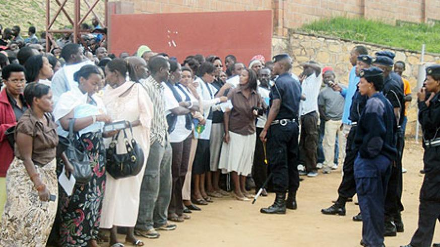 A group of Muhanga residents line up for checking before the provisional driving license tests. (Photo: D. Sabiiti)