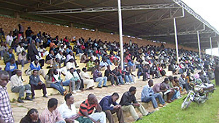 Residents who turned up for provisional driving license at Gicumbi stadium on Monday.  (Photo: A. Gahene)