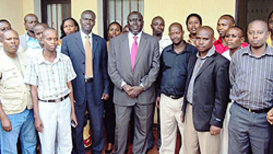 Ministers Tharcisse Karugarama and Stanislas Kamanzi pose for a photo with the newly sworn in land legal advisors. (Photo: S. Rwembeho)