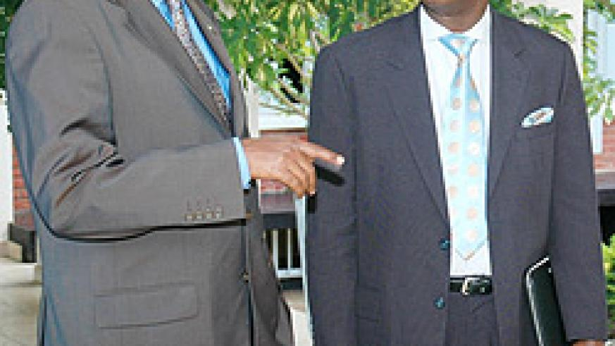 Prime Minister Bernard Makuza with Dalo Gbouable yesterday at the Prime Minister's office   (Photo; F. Goodman)