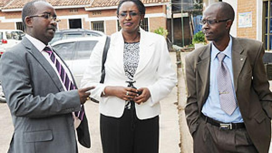 The Director General of Labour, Anna Mugabo(C) with CESTRAR's African Biraboneye and Jeremy Nsengiyumva after the meeting . (Photo: J. Mbanda)