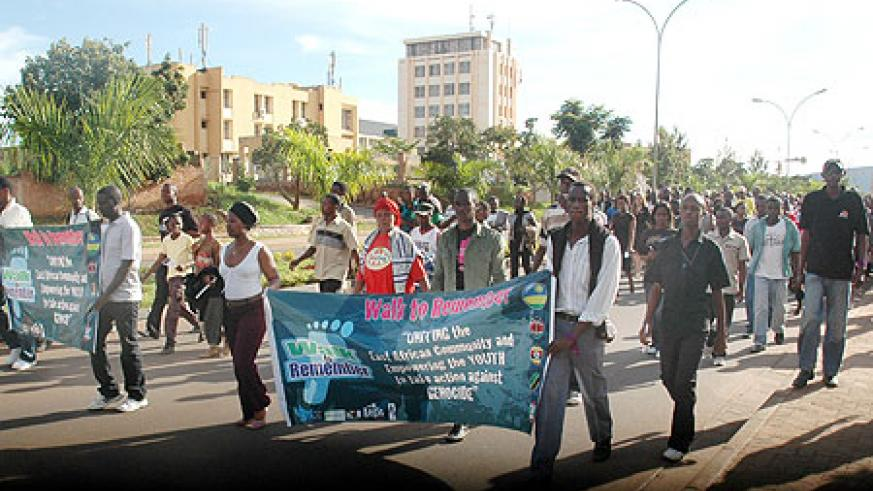 Youth from EAC partner states taking part in a march during the commemoration week. (Photo: J. Mbanda)