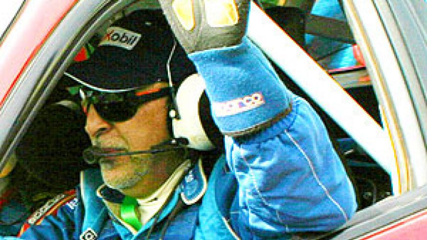 Fitidis salutes the crowd during last year's KCB Mountain Gorilla rally. (File Photo)