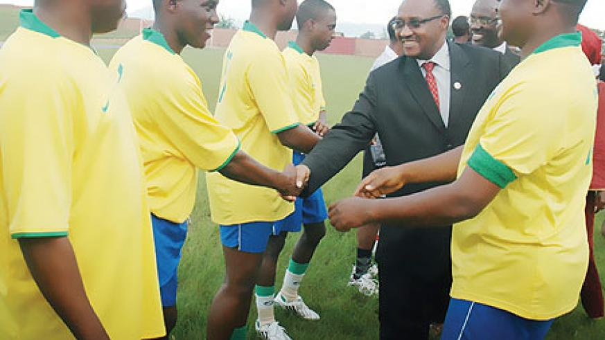 Minister Protais Musoni greets members of the media team at a match to mark the World Press Freedom Day in Muhanga District. (Photo; F. Goodman)