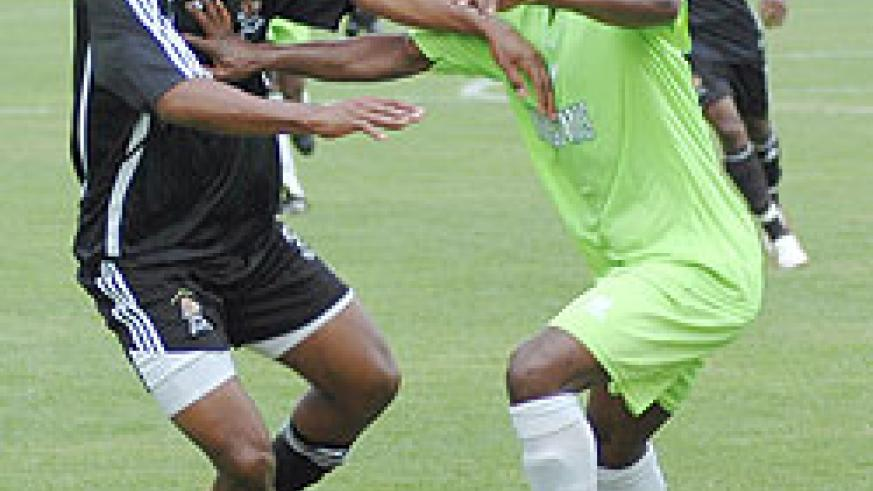 Nyirenda fights for the ball with a Kiyovu player in a previous league encounter. The Malawi striker scored APR's winner yesterday. (File Photo)