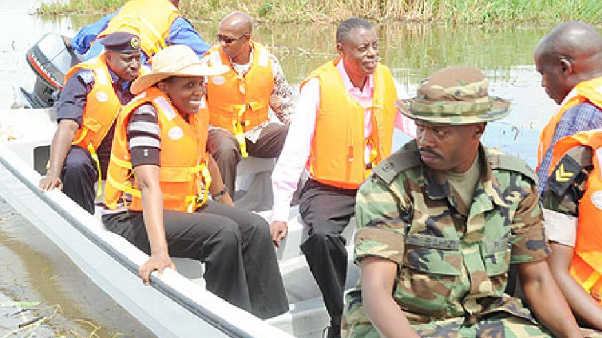 Ministers Kabarebe, Kalibata, Harelimana and Commissioner General of Police Emmanuel Gasana on one of the speed boats in Lake Mirayi in Bugesera District. (Photo/ J.Mbanda)
