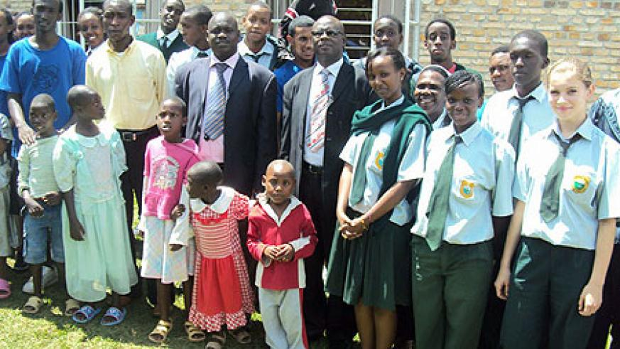 Green Hills Academy entourage poses for a group photo with the disabled children in Kamonyi. (Photo: D. Sabiiti)