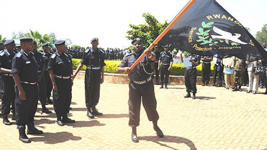 Commissioner General of Police Emmanuel Gasana flagging off the National Police 10th anniversary celebrations.