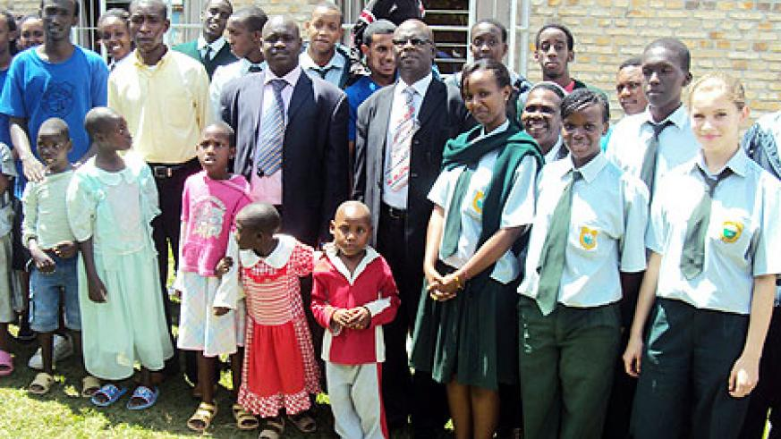 Green Hills Academy entourage poses for a group photo with disabled children in Kamonyi. (Photo / D. Sabiiti)