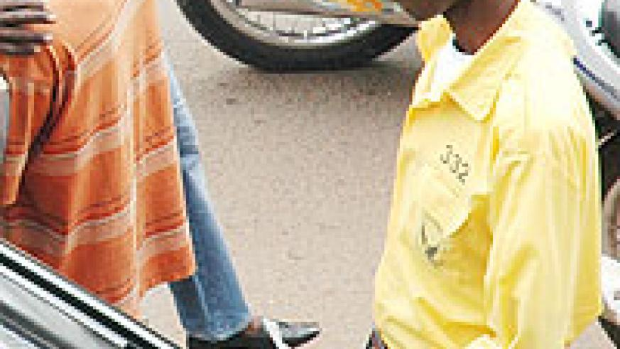 A Parking ticket vendor with KVCS. They claim to have taken six months without pay (File Photo)