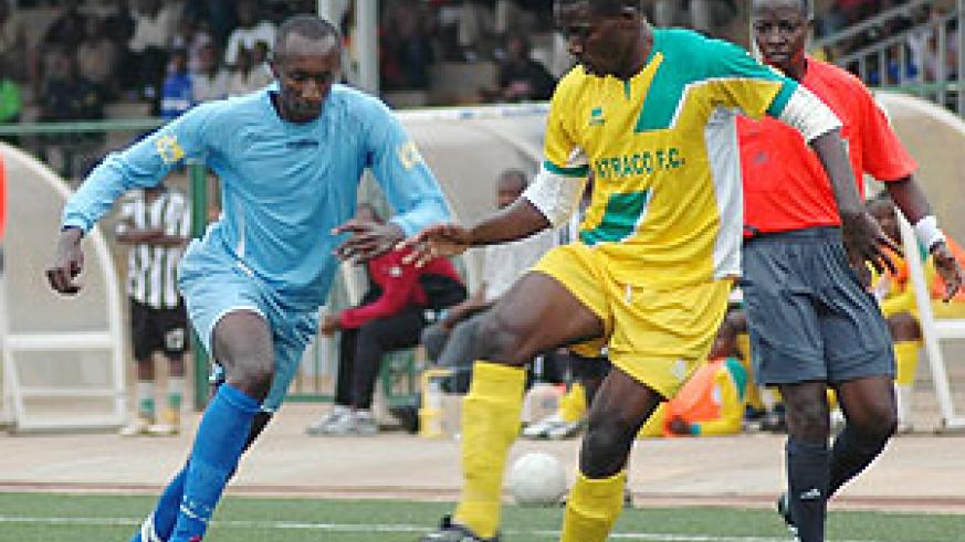 Rayon's Yusuf Ndayishimiye tries to challenge an Atraco defender. The two sides will face off in the MTN Peace Cup semi-final.