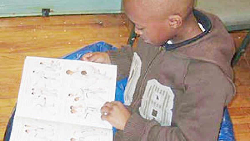 A child reading. Rwandan authors should be given more support.