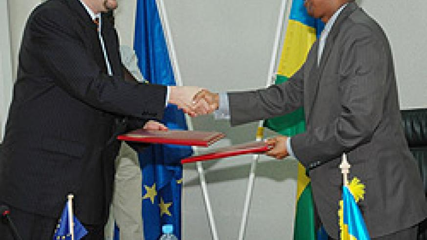 The Minister of Finance John Rwangombwa shaking hands with Amb. Michel Arrion after the signing of the agreement yesterday. (Photo; F. Goodman)