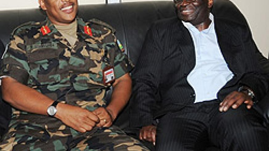 Prof.Ibrahim Gambari ( R) and Lt.Gen. Patrick Nyamvumba chat at Kigali International Airport recently. (File photo)