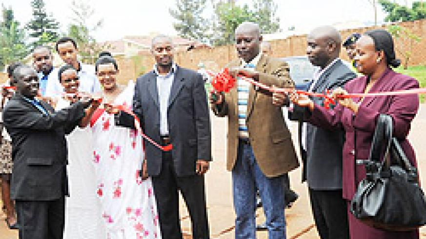 Mayor Jules Ndamage cutting the ribbon to launch the construction of the 2km road at Niboye junction yesterday. (Photo / F. Goodman)