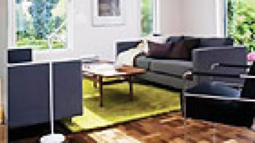 L-R : Using a bright colour is an effective way of bringing warmth into a black- greyish colour scheme ; A rug makes a huge difference, so incorporate one to make a living room feel complete ; Keep the design simple, yet don't hesitate to add charisma by