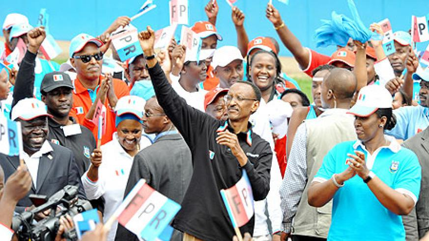 President Kagame celebrates with RPF Party members after being elected the Party's candidate for the 2010 Presidential elections. (Photo Urugwiro Village)