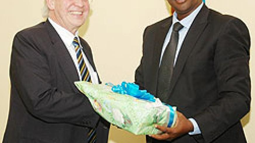 The Minister of Local government James Musoni (L) with Carl Wright Secretary-General of the Commonwealth Local Government Forum (Photo; F. Goodman)