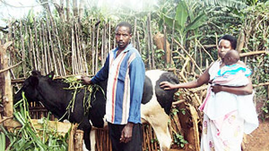 The couple admiring the cow. (Photo: S. Rwembeho)