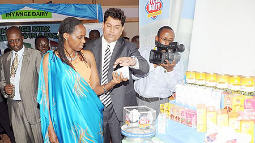 The Minister of Agriculture Dr. Agnes Kalibata takes a look at some of the Dairy Products on display at the Diary Exhibition yesterday. (Photo J. Mbanda)