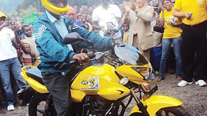 Bigirimana Ismael tests his newly acquired motorcycle. PhotoB Mukombozi